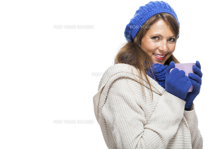 attractive pretty young woman with blue wool hat with long dark hairの写真素材 [FYI00740953]