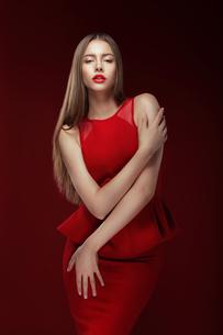 Elegance. Stylish Lady in Red Silky Dressの写真素材 [FYI00741307]