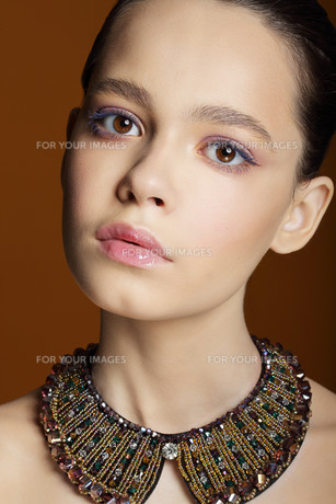 Portrait of Young Cute Woman with Necklaceの写真素材 [FYI00741315]