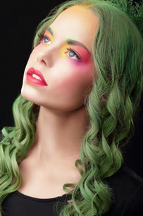 Imagination. Woman with Dyed hair and Fancy Creative Makeupの写真素材 [FYI00741329]