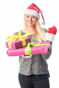 christmas woman with gifts a fistの素材 [FYI00741478]