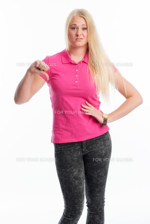 blonde woman showing thumbs downの素材 [FYI00741519]