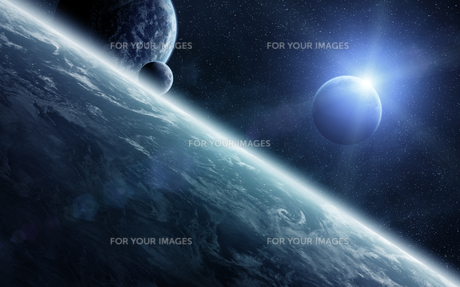 Sunrise over planets in spaceの写真素材 [FYI00742263]