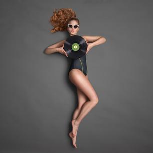 Bikini and vinyl.の写真素材 [FYI00742610]