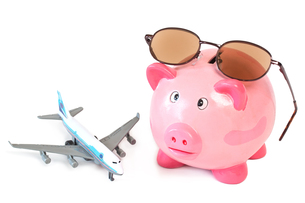 piggy bank with sunglasses and toy airplaneの素材 [FYI00742727]