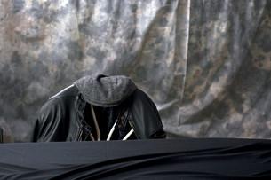 black leather jacket and capの写真素材 [FYI00742812]