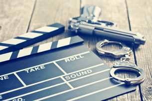 movie clapper and gun with handcuffsの写真素材 [FYI00742892]