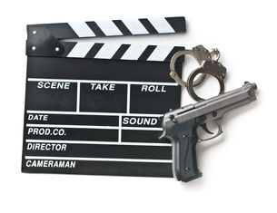 movie clapper and gun with handcuffsの写真素材 [FYI00742897]