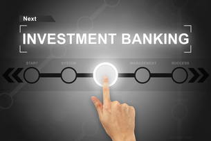 hand clicking investment banking button on a screen interfaceの写真素材 [FYI00743018]