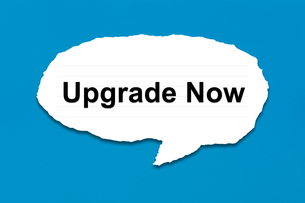 upgrade now with white paper tearsの写真素材 [FYI00743027]