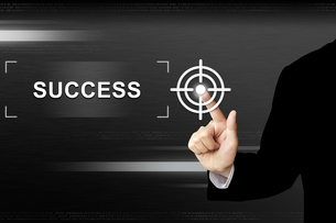 business hand pushing success button on touch screenの写真素材 [FYI00743032]
