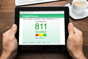 Person Hands With Digital Tablet Showing Credit Scoreの写真素材 [FYI00743096]