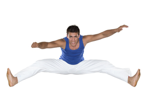 Capoeira, Brazilian Man jumping, white and blueの写真素材 [FYI00743720]