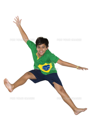 Soccer Boy, jumping, Brazilian flagの写真素材 [FYI00743723]