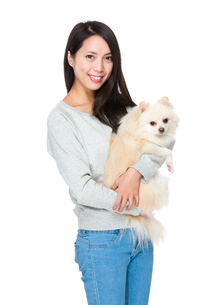 Woman hug with her lovely dogの写真素材 [FYI00743771]