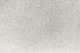 Grungy white concrete wall backgroundの写真素材 [FYI00744276]