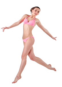 Beautiful young woman in pink swimwearの素材 [FYI00744370]