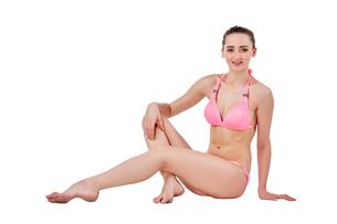 Beautiful young woman in pink swimwearの素材 [FYI00744393]