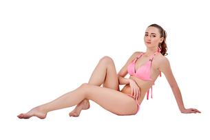 Beautiful young woman in pink swimwearの素材 [FYI00744398]