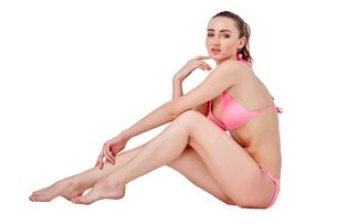 Beautiful young woman in pink swimwearの素材 [FYI00744406]