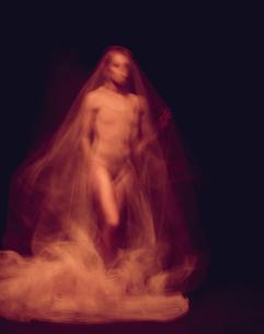 sensual and emotional dance of beautiful ballerina through the veilの写真素材 [FYI00744567]