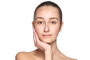 Portrait of beautiful girl stroking her face with healthy skinの写真素材 [FYI00744603]