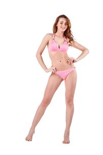 Beautiful young woman in pink swimwearの素材 [FYI00744605]