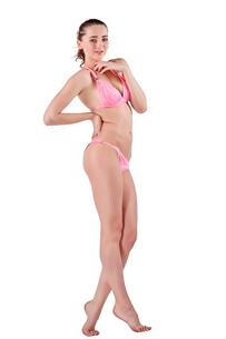 Beautiful young woman in pink swimwearの素材 [FYI00744643]