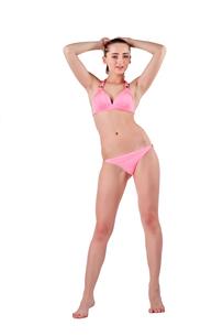 Beautiful young woman in pink swimwearの素材 [FYI00744655]