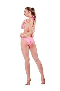 Beautiful young woman in pink swimwearの素材 [FYI00744659]