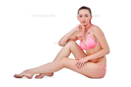 Beautiful young woman in pink swimwearの素材 [FYI00744670]
