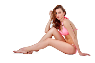Beautiful young woman in pink swimwearの素材 [FYI00744675]