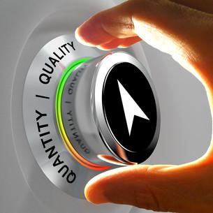 Quality versus Quantity. Hand adjusting the level of items.の写真素材 [FYI00745560]