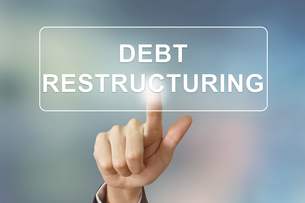 business hand clicking debt restructuring button on blurred backgroundの写真素材 [FYI00745854]