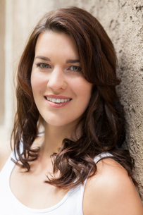 young attractive woman with dark hair in the portrait laughingの写真素材 [FYI00745866]