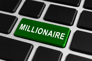millionaire button on keyboardの写真素材 [FYI00745868]