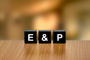 E&P or Exploration and Production on black blockの写真素材 [FYI00745874]