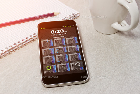 Workplace with mobile phoneの写真素材 [FYI00745993]