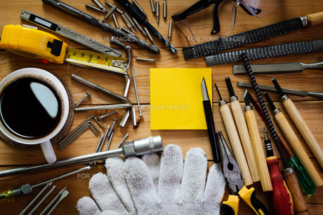 tools equipment with coffee and notepad on woodの写真素材 [FYI00746453]