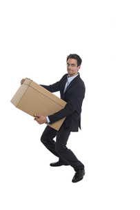 businessman with a boxの写真素材 [FYI00747031]