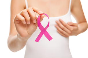 Woman with breast cancer awareness ribbonの写真素材 [FYI00749782]