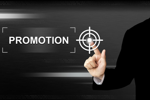 business hand pushing promotion button on touch screenの写真素材 [FYI00751165]