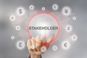 business hand pushing stakeholder buttonの写真素材 [FYI00751175]