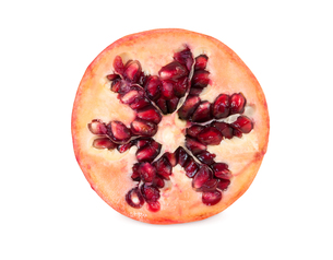 half of pomegranate fruits on white backgroundの写真素材 [FYI00751243]