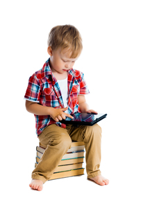 boy in a plaid shirt with a tablet computerの写真素材 [FYI00751960]