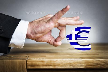 Man shoots greek Euro sign offの写真素材 [FYI00751972]