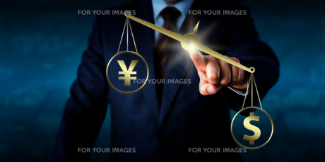US Dollar Outweighing The Yuan On A Golden Scaleの写真素材 [FYI00752597]