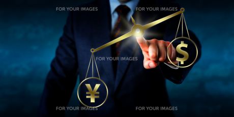Yuan Outweighing The Dollar On A Golden Balanceの写真素材 [FYI00752599]