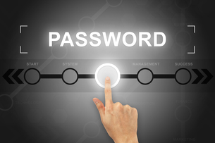 hand clicking password button on a screen interfaceの写真素材 [FYI00752978]