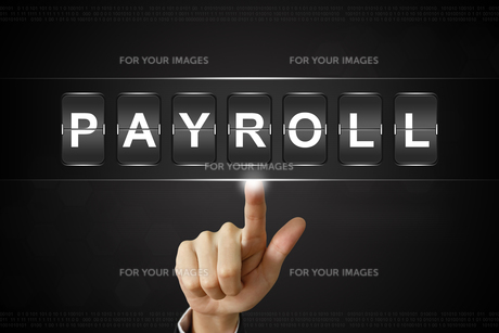 business hand clicking payroll on Flipboardの写真素材 [FYI00752984]